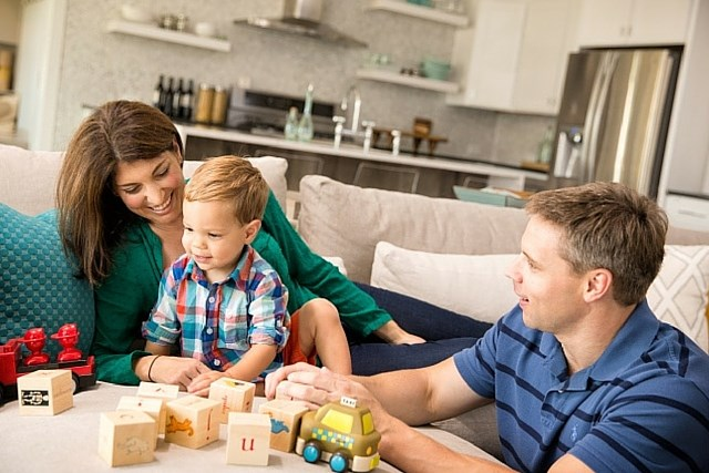 family with little boy in living area